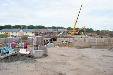 Perceton, Irvine, Scotland, UK - June 23, 2020: Building sites in Scotland start to get back to work after covid-19 corona virus lockdown. Dawn Homes at Perceton back on site. Éditoriale