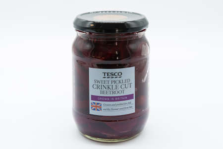 Irvine, Scotland, UK - March 08, 2020: Tesco branded sweet pickled crinkle cut beetroot in glass jar and metal lid with label dis[laying Union Jack flag of the UK.