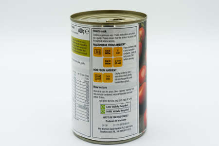 Irvine, Scotland, UK - March 08, 2020: Morrisons Italian Plum Tomatoes in recyclable tin can and ring pull lid. Label displaying recycling symbols and cooking instructions,