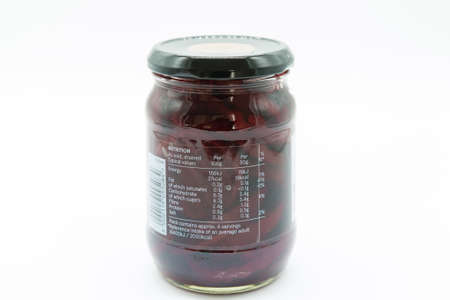 Irvine, Scotland, UK - March 08, 2020: Tesco branded sweet pickled crinkle cut beetroot in glass jar and metal lid with label displaying nutrition, ingredients recycling and e symbol.
