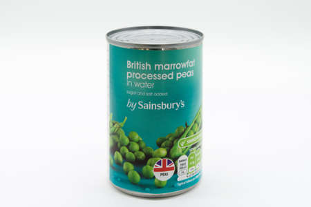 Irvine, Scotland, UK - March 08, 2020: Sainsbury's Branded  British Marrowfat Peas in recyclable tin can and lid. Label displays Kcal and energy values and 'e' symbol. Recycling Symbol and vegetarian 'V' symbols are also displayed on label.