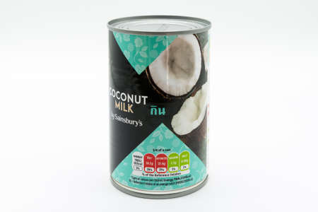 Irvine, Scotland, UK - March 08, 2020: Sainsbury's Branded Coconut Milk in recyclable tin can and lid. Label displays Kcal and energy values. 新闻类图片