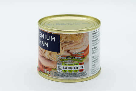 Irvine, Scotland, UK - March 08, 2020: Morrisons branded Premium ham in recyclable tin can and recyclable tin lid. Label displaying 'e' symbol and nutritional information and ingredients listed with relevant Kcal values.