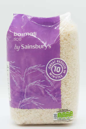 Irvine, Scotland, UK - March 08, 2020: Sainsbury's  Branded basmati rice in a plastic bag displaying Kcal and energy value symbols.