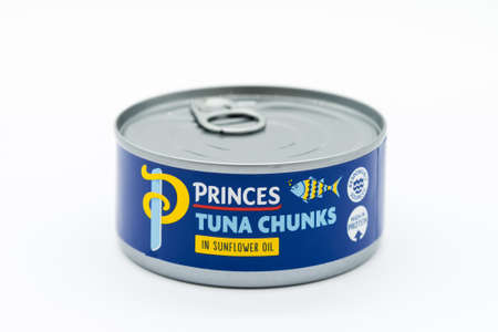 Irvine, Scotland, UK - March 08, 2020: Princes branded Tuna Chunks in sunflower oil 'Responsibly Sourced' and 'High in Protein' symbols displayed at edge of label. Can and lid are widely recycled across UK.