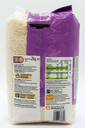 Irvine, Scotland, UK - March 08, 2020: Sainsbury's  Branded basmati rice in a plastic bag displaying Kcal and energy value symbols, vegan symbol, 'e' symbol, non-recyclable symbol for plastic bag, and cooking instruction symbols. 新闻类图片