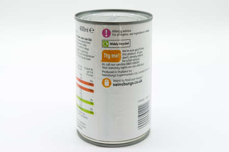 Irvine, Scotland, UK - March 08, 2020: Sainsbury's Branded Coconut Milk in recyclable tin can and lid. Label displays Kcal and energy values and 'e' symbol. Recycling Symbol also displayed on label.