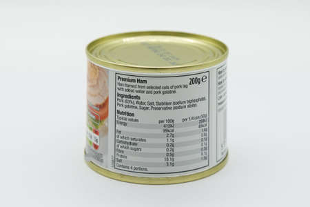 Irvine, Scotland, UK - March 08, 2020: Morrisons branded Premium ham in recyclable tin can and recyclable tin lid. Label displaying 'e' symbol and nutritional information and ingredients listed.