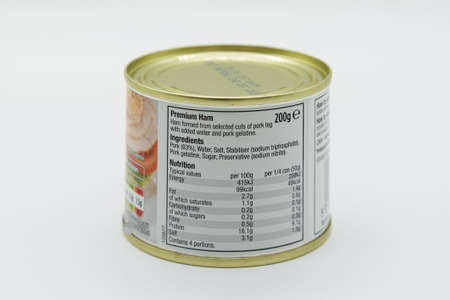 Irvine, Scotland, UK - March 08, 2020: Morrisons branded Premium ham in recyclable tin can and recyclable tin lid. Label displaying 'e' symbol and nutritional information and ingredients listed. 免版税图像 - 153231008