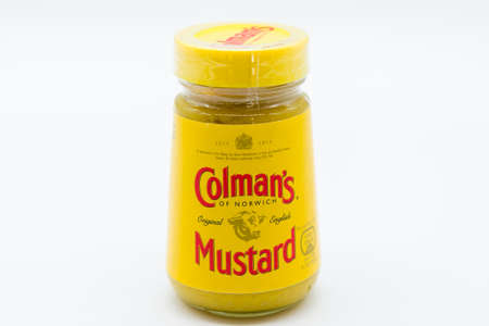 Irvine, Scotland, UK - March 08, 2020: Colman's Branded Mustard in recyclable glass jar and plastic lid. Label displaying company information and the HM Royal Seal of approval 1814 also displayed.