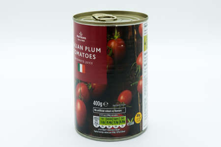 Irvine, Scotland, UK - March 08, 2020: Morrisons Italian Plum Tomatoes in recyclable tin can and ring pull lid. Label displaying 'e' symbol vegan symbol and Kcal energy Information.