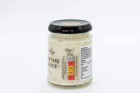 Irvine, Scotland, UK - August 08, 2020: Morrisons Branded jar of Tartare Sauce in recyclable glass jar and metal lid.2020: Morrisons Branded jar of Tartare Sauce in recyclable glass jar and metal lid with jar displaying Kcal values and nutritional values. 新闻类图片