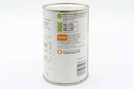 Irvine, Scotland, UK - March 08, 2020: Sainsbury's Branded  Peach Slices in recyclable tin can and lid. Label displays recycling symbols and 1of5 day symbol.