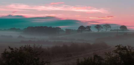Ayrshire Fields and a etherial misty sunrise with the mist lying low on the on the farmers fields.