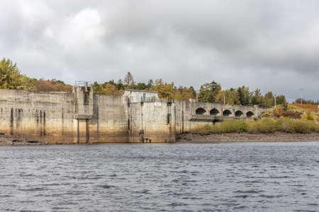 Dalmelloington, Scotland, UK - October 10, 2020: Loch Doon Hydro Dam at the far end of Loch Doon in Ayrshire Scotland.