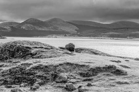 Loch Doon and the Galloway Hills in the far distance with a broody winter sky. 免版税图像