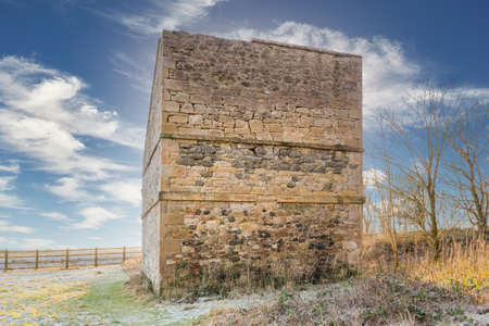 Irvine, Scotland, UK - January 02, 2021: The ancient architecture of the old Dovecots, doocots or culverhouses as they were known. This is the rear of the building and was used to keep pigeons by wealthy landowners in ancient times and is situated within