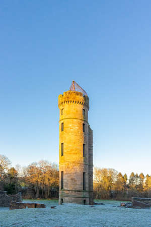 Irvine, Scotland, UK - January 02, 2021: Eglinton Park in winter at the start of the year with its footpaths, castle ruins, and in particular the old castle tower.
