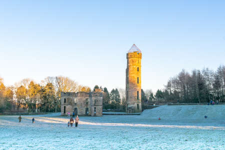 Irvine, Scotland, UK - January 02, 2021: Eglinton Park in winter at the start of the year with its footpaths, castle ruins, and in particular the old castle tower and out buildings.