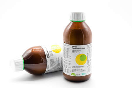 Irvine, Scotland, UK - January 09, 2021: Peptac Branded Peppermint Liquid by MA Pinewood laboratories in two 500ml recyclable glass bottle and label giving full instructions and chemical content. 新闻类图片