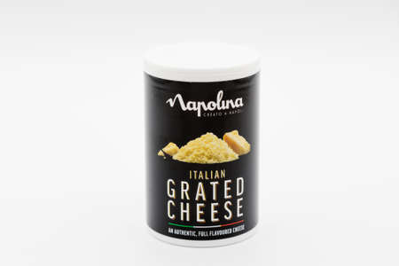 Irvine, Scotland, UK - January 09, 2021: Napolina branded Italian grated cheese in a recyclable plastic container and plastic lid.