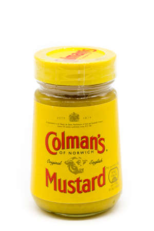 Irvine, Scotland, UK - January 09, 2021: Colman's of Norwich branded mustard in a recyclable glass jar and plastic lid with the brand symbol displayed displayed on the label.