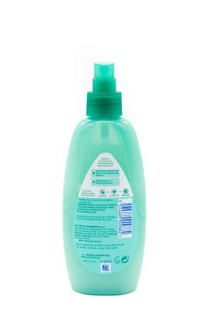 Irvine, Scotland, UK - January 09, 2021: Johnson and Johnson branded kids hair product in a recyclable plastic bottle and plastic pump dispenser and rear label with symbols.