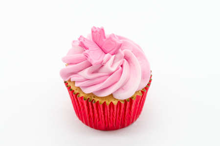 Easter cup cake with pink icing and red sponge casings on a white background.