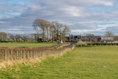 Irvine, Scotland, UK - March 5, 2021: Muirhouses farm buildings on the old medieval settlement that is Perceton which was once part of an old country estate near Irvine. 新闻类图片