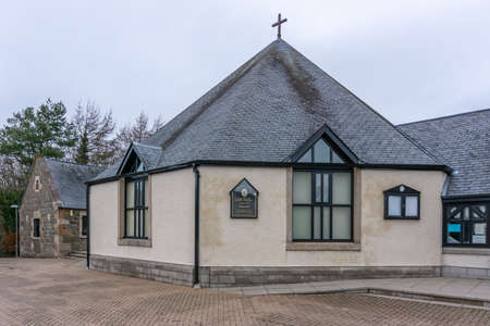 Irvine, Scotland, UK - February 24, 2021: The octagonal roof design of Girdle Toll church by the architect Ian Hepburn. Built in 1992 on an old farm steading where they incorporated the old farm buildings into the outer church halls and manse.