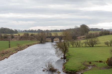 Looking down from Laigh Milton Viaduct to the newer Gatehead Viaduct built in 1865 over the River Irvine. 免版税图像
