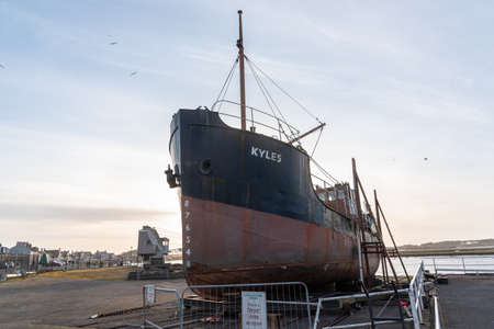 Irvine, Scotland, UK - April 14, 2019: Irvine Harbour North Ayrshire Scotland and the old Museum where the old Puffer Boat KYLES is presently on dry land where it can be inspected by the public. 新闻类图片