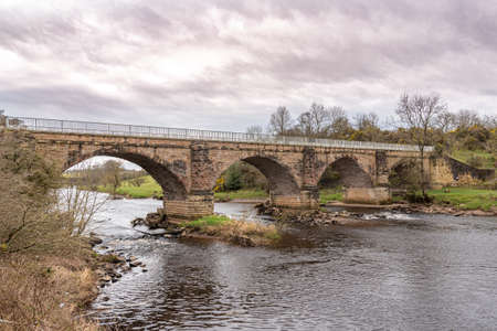 Gatehead, Irvine, Scotland, UK - March 23, 2021: Laigh Milton Viaduct is thought to be the Oldest surviving Public railway viaducts. It is a category A listed structure which was built for the Kilmarnock and Tron railway in 1812. The line was a horse draw