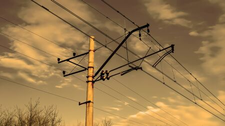 Concrete support of high voltage wires, on the background the sky. Power line of electric trains bottom view. High voltage line.