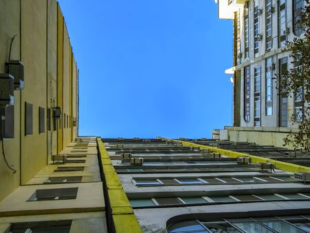 High-rise building on a background of blue sky with white clouds. Bottom view. Ukraine. Dnieper.