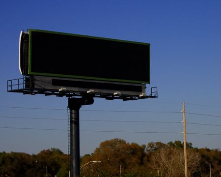 Empty roadside billboard on pole