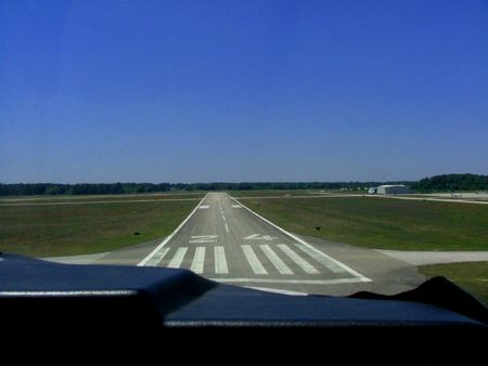 View out the front of a small plane seconds from landing