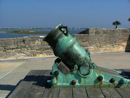 Short ornate spanish cannon with green patina at the Castillo San Marco Banco de Imagens
