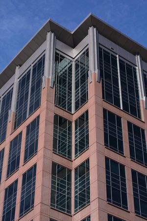 sharply: Sharply angled modern looking building against sky Stock Photo