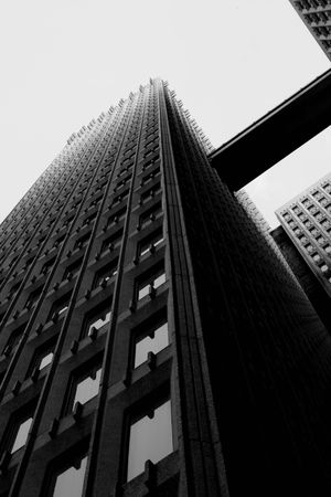 Black and White very high contrast view of skyscrapers with catwalk