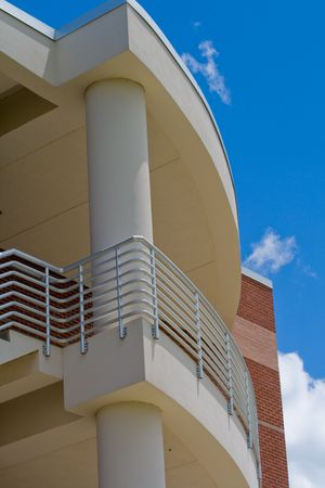 Detail of modern building showing balcony with sky in the background Stock Photo