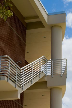 Detail of modern building showing staircase with sky in the background