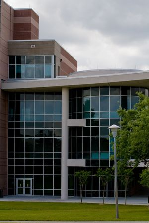 Detail of a modern building on a college campus with sky in background Stock Photo