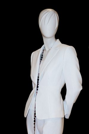 Stylish mannequin isolated against black background wearing pant suit