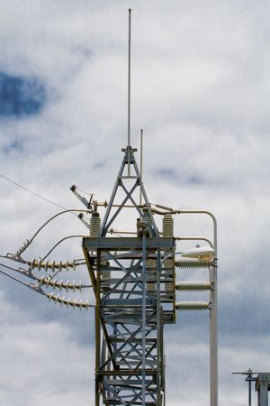 Power transmission tower at a powoer substation with an array of lines