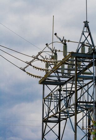 Power transmission tower at a power substation with an array of lines