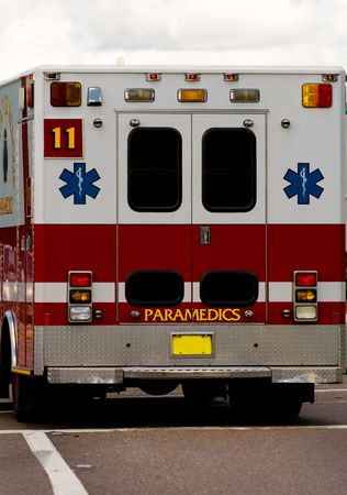Close up of the rear of a red and white ambulence