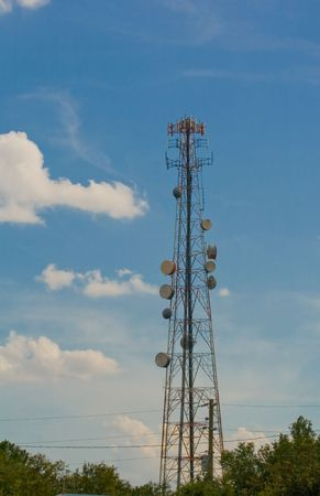 microwave antenna: Antenna tower with microwave transceivers and cell antennas Stock Photo