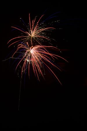 newyears: Red and blue shell bursts in the night Stock Photo