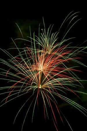 newyears: Red and green shell bursts in the night sky